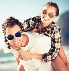 image of man and woman and wearing sunglasses.